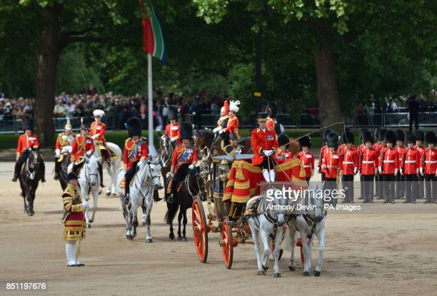 Queen Elizabeth II arrives followed by the Duke of Cambridge Princess Royal and the Prince of Wales arrive at Horse Guards Parade London to attend...