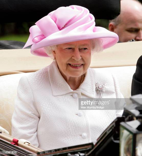 Queen Elizabeth II arrives in a horse drawn carriage as shey attends day 2 of Royal Ascot at Ascot Racecourse on June 15 2011 in Ascot United Kingdom