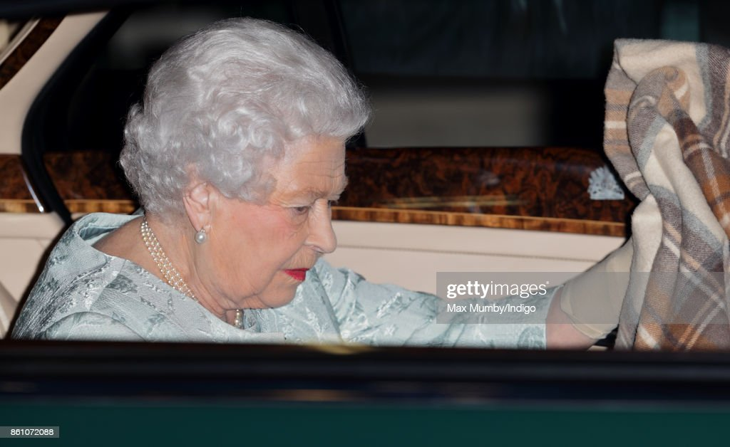 Queen Elizabeth II arrives in her Bentley car to attend a reception to mark the Centenary of the Women's Royal Navy Service and the Women's Auxiliary Army Corp at The Army & Navy Club on October 12, 2017 in London, England.