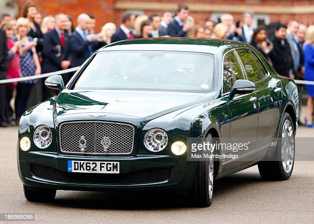 Queen Elizabeth II arrives in her Bentley car to attend the QIPCO British Champions Day at Ascot Racecourse on October 19 2013 in Ascot England