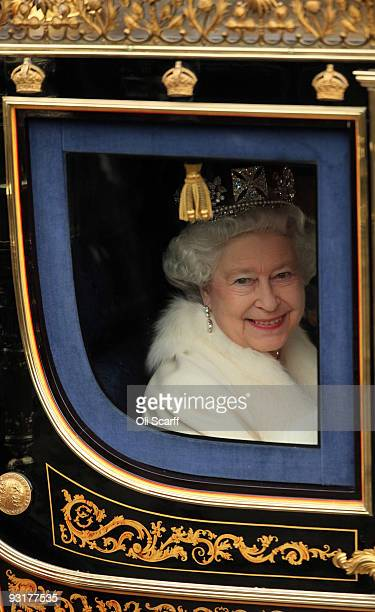 Queen Elizabeth II arrives in her carriage for the State Opening of Parliament on November 18 2009 in London England Queen Elizabeth II unveiled the...