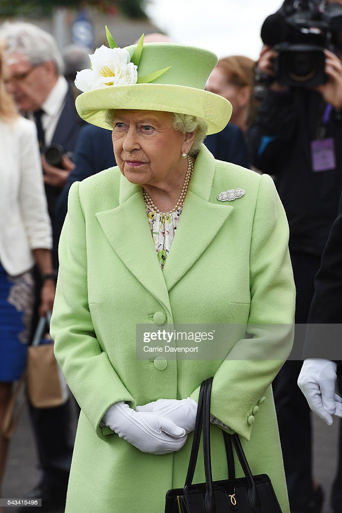 Queen <a gi-track='captionPersonalityLinkClicked' href=/galleries/search?phrase=Elizabeth+II&family=editorial&specificpeople=67226 ng-click='$event.stopPropagation()'>Elizabeth II</a> arrives on a steam train to open the new Bellarena Station village on June 28, 2016 in Bellarena, Northern Ireland.