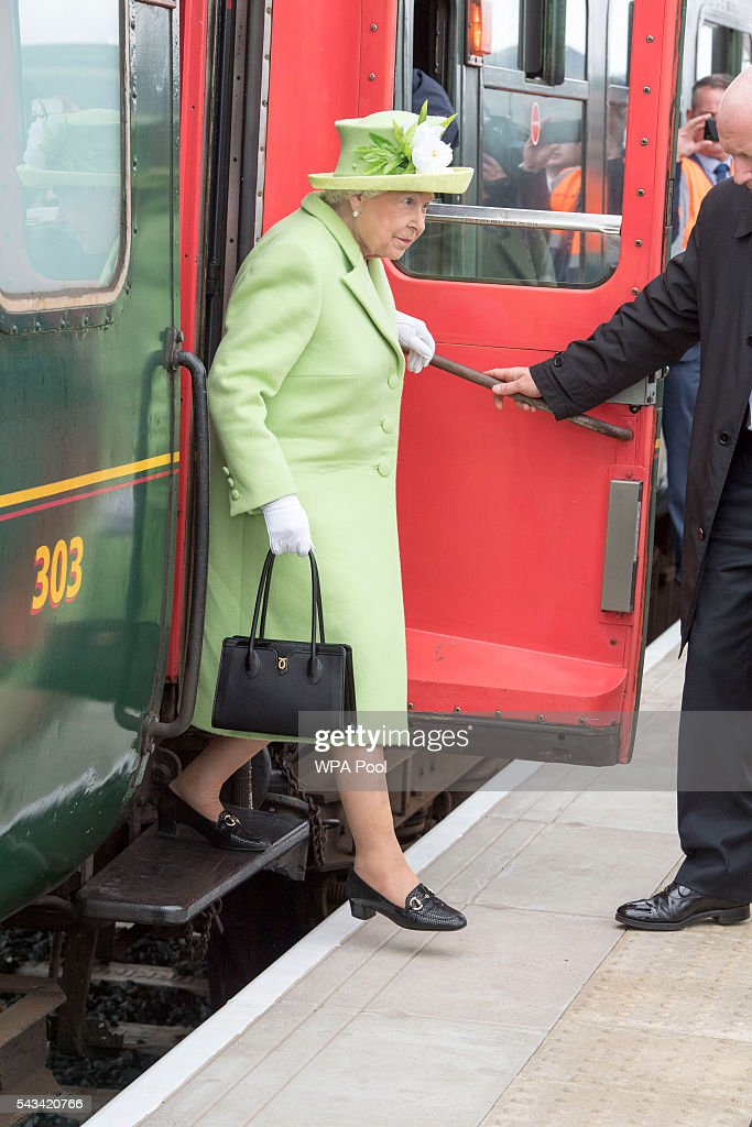 Queen Elizabeth II arrives on a steam train to open the new Bellarena Station village after travelling from Coleraine Railway Station on June 28, 2016 in Bellarena, Northern Ireland, United Kingdom. The Queen and The Duke of Edinburgh unveiled a plaque to mark the opening of the Bellarena Railway Station before they departed Northern Ireland.