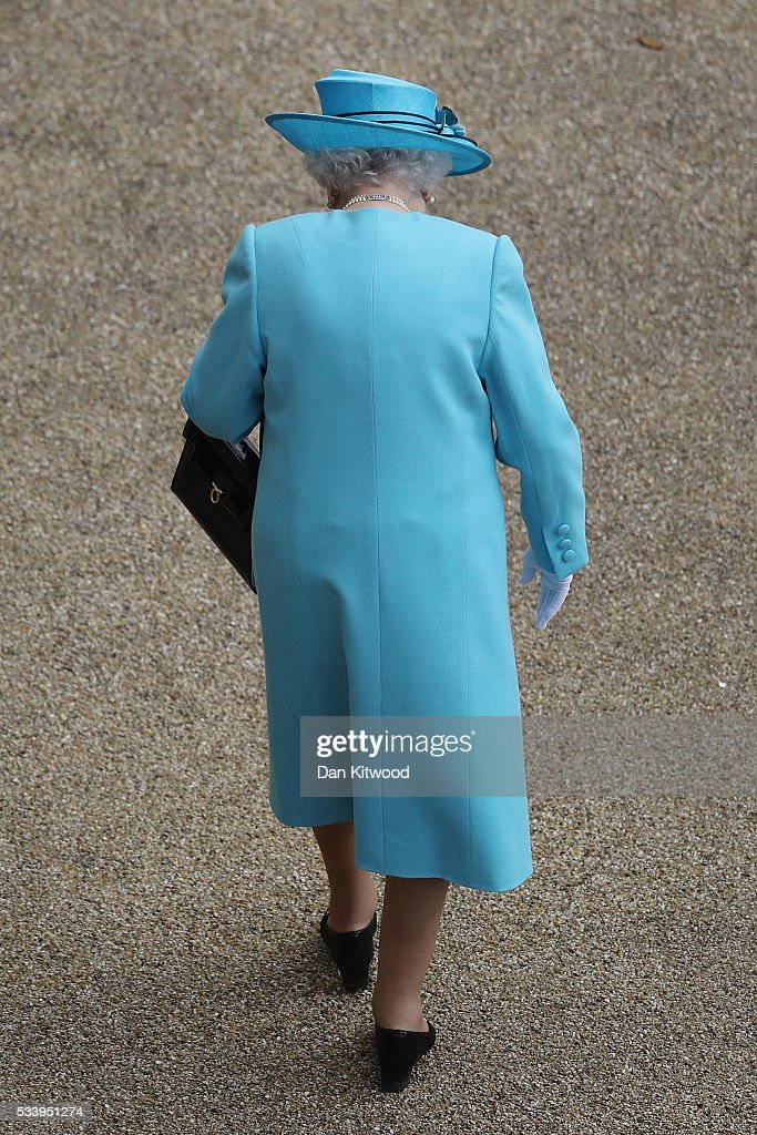 Queen Elizabeth II arrives to greet guests attending a garden party at Buckingham Palace on May 24, 2016 in London, England.