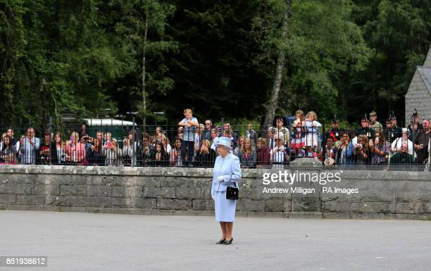 Queen Elizabeth II arrives to inspect the Royal Scots Borderers at the gates to Balmoral as she takes up summer residence there
