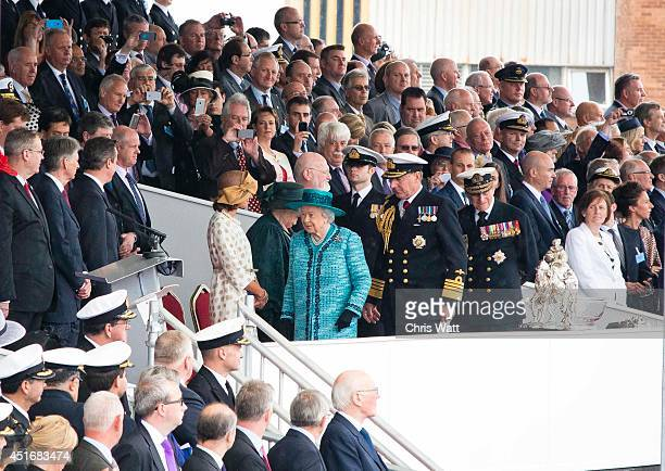 Queen Elizabeth II arrives to officially name the Royal Navy's new aircraft carrier HMS Queen Elizabeth on July 4 2014 in Rosyth Scotland HMS Queen...