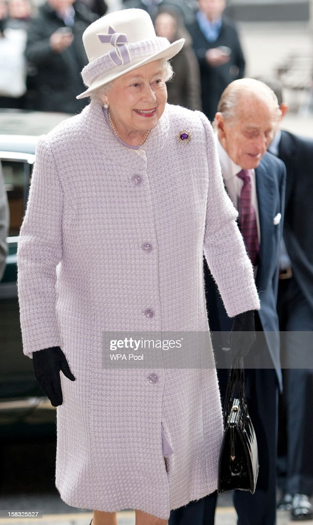 Queen Elizabeth II arrives to visit the Bank of England with Prince Philip, Duke of Edinburgh on December 13, 2012 in London, England. Governor, Sir Mervyn King met with the Queen and Duke before they visited the Banking Hall to discuss payment system controls. The royal couple viewed banknotes, counterfeit currency, a gold vault, historical items, met with gold experts, security staff and the Market Operations Office while on their visit to the Bank of England.