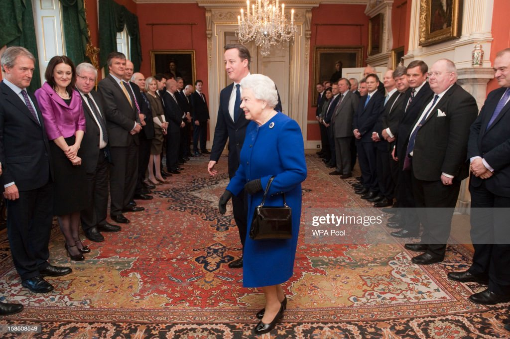 Queen Elizabeth II arrives with British Prime Minister David Cameron to meet members of the cabinet at Number 10 Downing Street as she attends the Government's weekly Cabinet meeting on December 18, 2012 in London, England. The Queen's visit to the weekly Cabinet meeting as an observer is the first time a monarch has attended the meeting since Queen Victoria's reign.