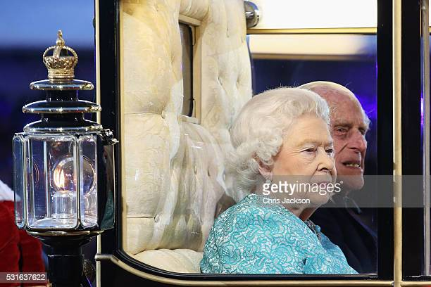 Queen Elizabeth II arrives with Prince Philip Duke of Edinburgh to attend a 90th Birthday Celebration show at Windsor Castle on May 15 2016 in...