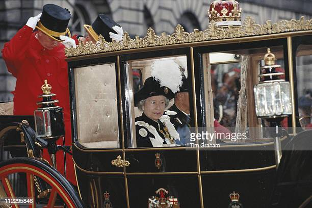 Queen Elizabeth II arriving by horsedrawn carriage at St Giles Cathedral Edinburgh for the Order of the Thistle ceremony Scotland Great Britain 4...