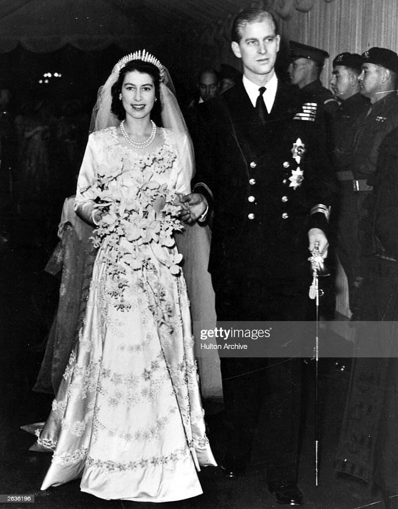 Queen Elizabeth II, as Princess Elizabeth, and her husband the Duke of Edinburgh, styled <a gi-track='captionPersonalityLinkClicked' href=/galleries/search?phrase=Prince+Philip&family=editorial&specificpeople=92394 ng-click='$event.stopPropagation()'>Prince Philip</a> in 1957, on their wedding day. She became queen on her father King George VI's death in 1952.