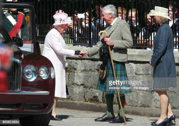 Queen Elizabeth II as she arrives to inspect the Argyll and Sutherland Highlanders at the gates to Balmoral as she takes up summer residence there