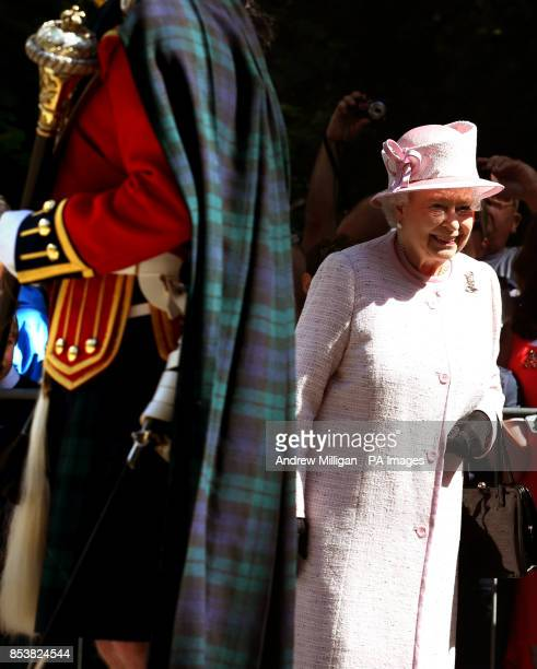 Queen Elizabeth II as she inspects the Argyll and Sutherland Highlanders at the gates to Balmoral as she takes up summer residence there