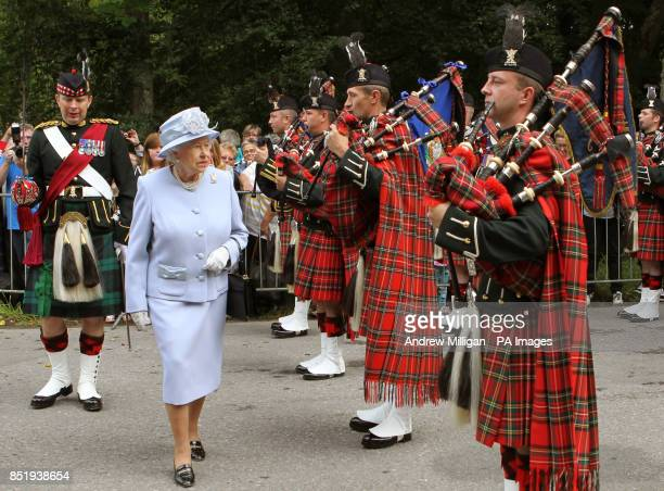 Queen Elizabeth II as she inspects the Royal Scots Borderers at the gates to Balmoral as she takes up summer residence there