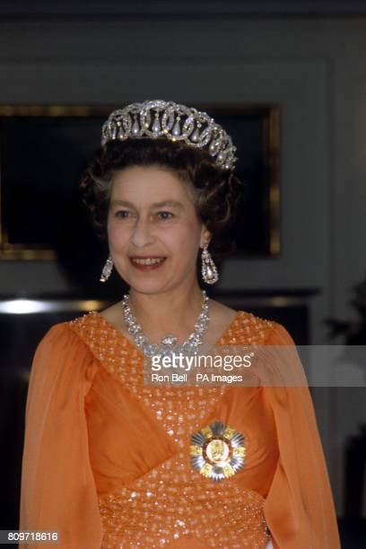 Queen Elizabeth II at a dinner on board the Royal Yacht Britannia for Sheikh Zayed bin Sultan Al Nahyan Ruler of Abu Dhabi and President of the...