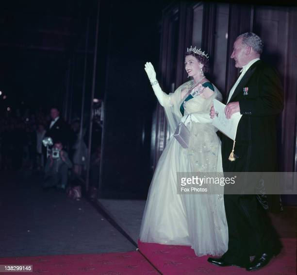 Queen Elizabeth II at a State Banquet in Canberra Australia February 1954 The Queen is wearing a mimosa gold tulle dress patterned with an Australian...