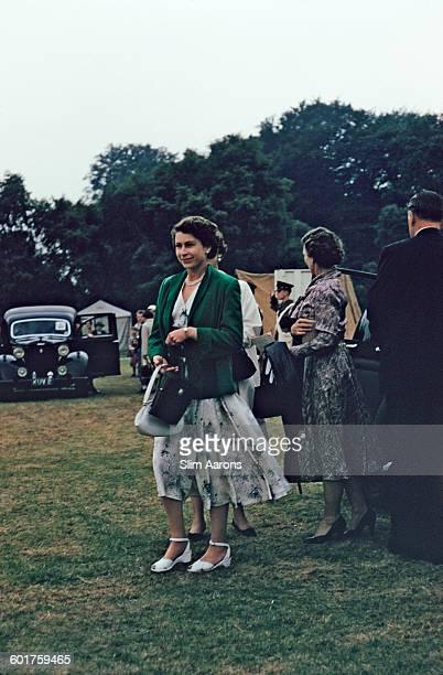 Queen Elizabeth II at the Ascot Week polo tournament in Windsor Great Park June 1955