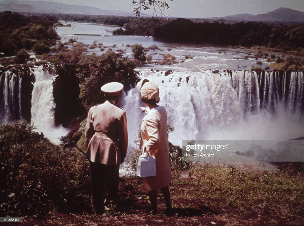 Queen Elizabeth II at the impressive Tissisal Falls, where the Blue Nile begins, with Emperor Haile Selassie during a royal visit to Ethiopia, February 1965.