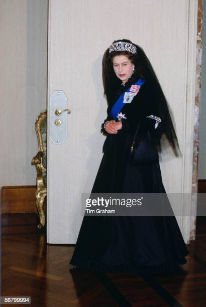 Queen Elizabeth II at the Vatican for an audience with the Pope The Queen is wearing the traditional black full length dress that protocol demands...