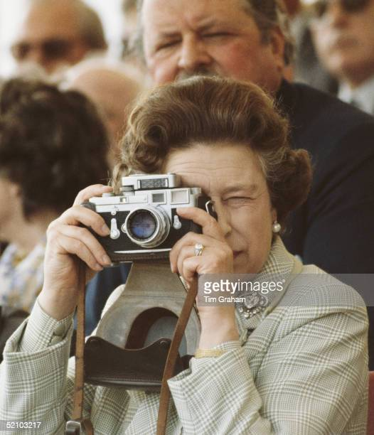 Queen Elizabeth II At The Windsor Horse Show She Is Taking Pictures Of Her Husband With Her Leica M3 Camera Wearing Her Engagement Ring And The...