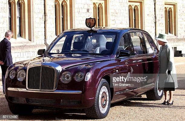 Queen Elizabeth II At Windsor Castle Inspecting The New Bentley State Limousine Car Presented To Her As A Golden Jubilee Gift On Behalf Of A...