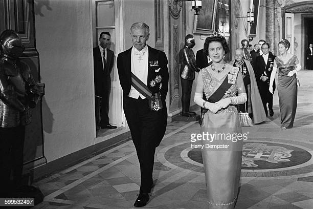 Queen Elizabeth II attends a banquet during a Commonwealth visit to Malta accompanied by Maurice Henry Dorman the GovernorGeneral of Malta 14th...
