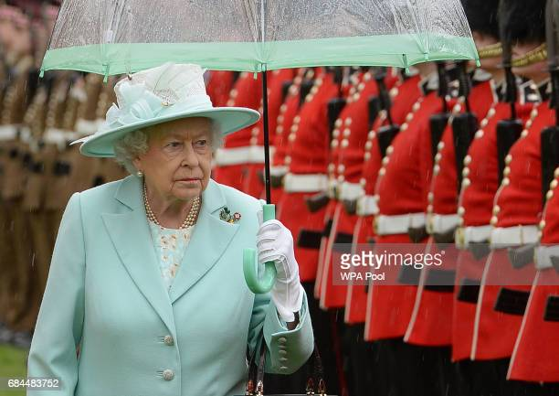 Queen Elizabeth II attends a ceremony to present new colours to the 1st Battalion and and F Company Scots Guards at Buckingham Palace on May 18 2017...