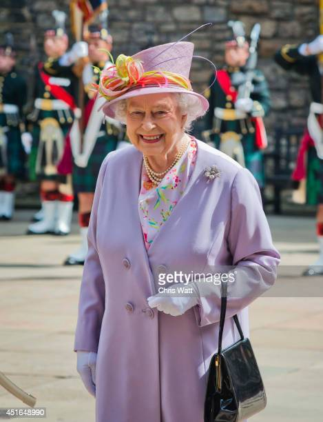 Queen Elizabeth II attends a commemorative service at the Scottish National War Memorial at Edinburg Castle on July 3 2014 in Edinburgh Scotland The...