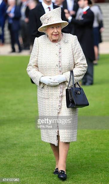 Queen Elizabeth II attends a garden party in the grounds of Buckingham Palace on May 20 2015 in London England