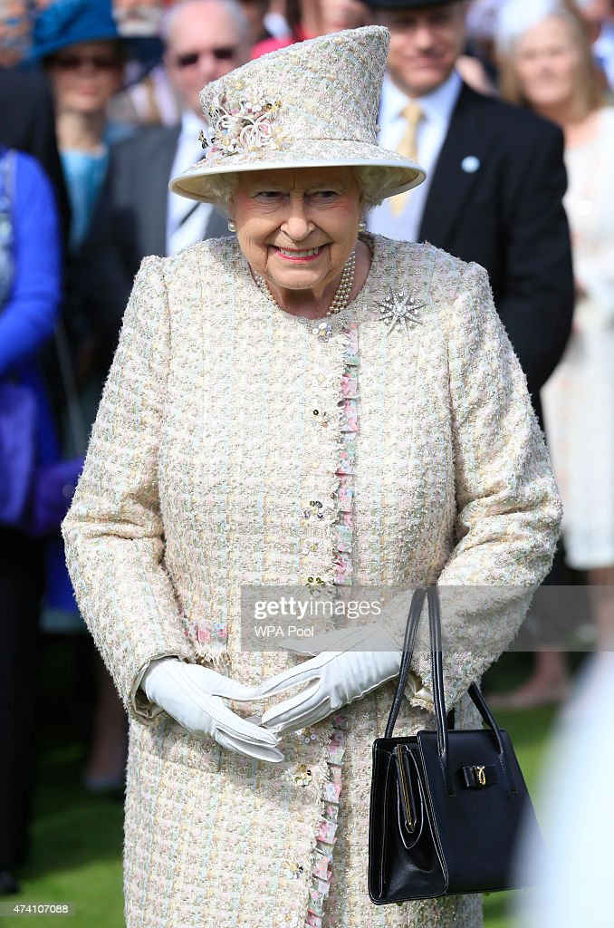 Queen Elizabeth II attends a garden party in the grounds of Buckingham Palace on May 20, 2015 in London, England.