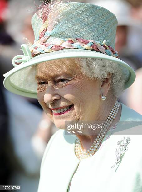 Queen Elizabeth II attends a Garden Party she is hosting at Buckingham Palace on June 6 2013 in London England