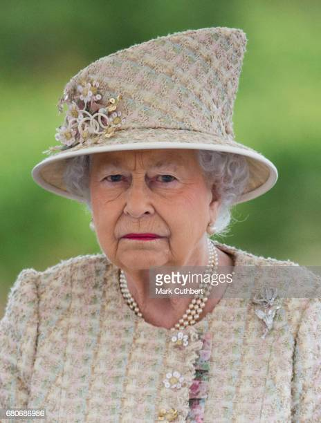 Queen Elizabeth II attends a parade during a visit to Pangbourne College to celebrate it's centenary on May 9 2017 in Pangbourne England