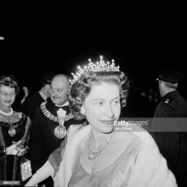 Queen Elizabeth II attends a performance at RADA to celebrate the drama school's Diamond Jubilee London UK November 1964