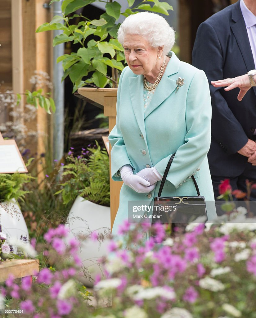Queen Elizabeth II attends Chelsea Flower Show press day at Royal Hospital Chelsea on May 23, 2016 in London, England. The prestigious gardening show features hundreds of stands and exhibition gardens.