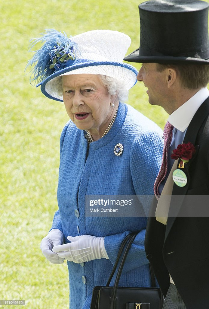 Queen Elizabeth II (L) attends Day 4 of Royal Ascot at Ascot Racecourse on June 21, 2013 in Ascot, England.