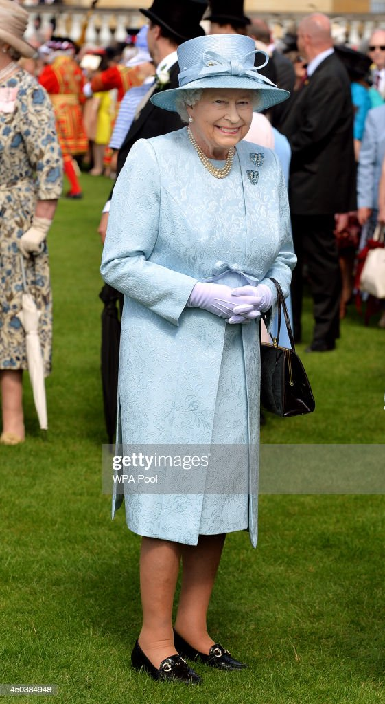Queen Elizabeth II attends her garden party held at Buckingham Palace on June 10, 2014 in London, England. She is wearing a hat by Philip Somerville.
