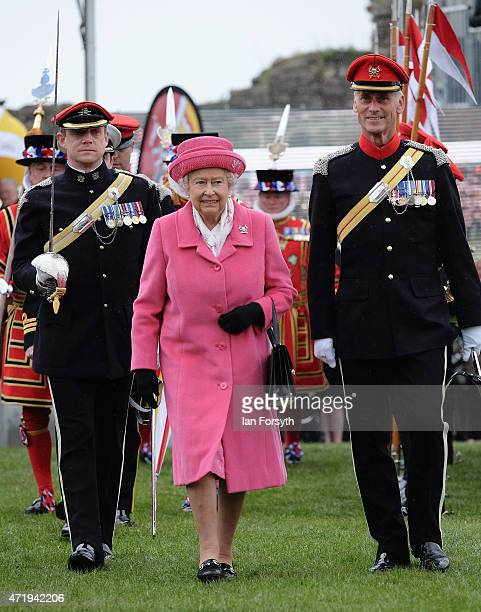Queen Elizabeth II attends the amalgamation parade of The Queen's Royal Lancers and 9th/12th lancers at Richmond Castle on May 2 2015 in Richmond...