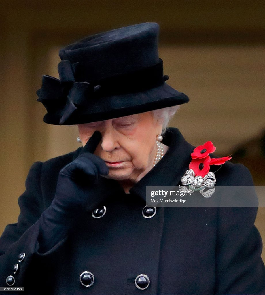 Queen Elizabeth II attends the annual Remembrance Sunday Service at The Cenotaph on November 12, 2017 in London, England. This year marks the first time that Queen Elizabeth II watched the service from a balcony rather than lay her own wreath, instead Prince Charles, Prince of Wales laid her wreath on her behalf.