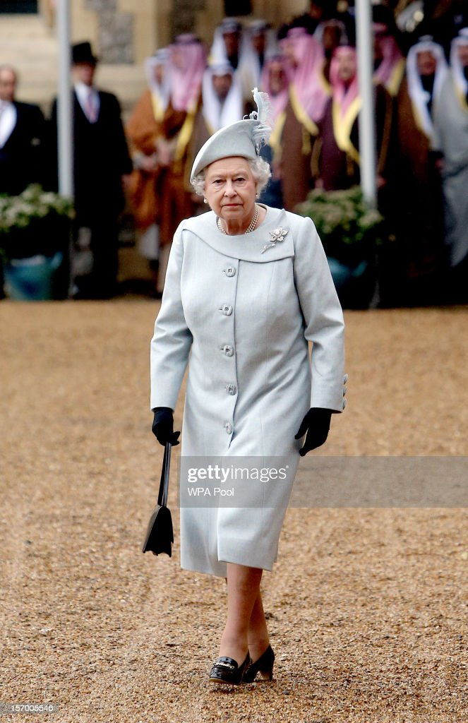 Queen <a gi-track='captionPersonalityLinkClicked' href=/galleries/search?phrase=Elizabeth+II&family=editorial&specificpeople=67226 ng-click='$event.stopPropagation()'>Elizabeth II</a> attends the ceremonial arrival of Amir Sheikh Sabah Al-Ahmad Al-Jaber Al-Sabah of Kuwait at Windsor Castle during a three-day state visit on November 27, 2012 in Windsor, England. In the afternoon a military parade will be inspected at Royal Military Academy Sandhurst then a banquet is to be held at Windsor Castle in the Amir's honour this evening.