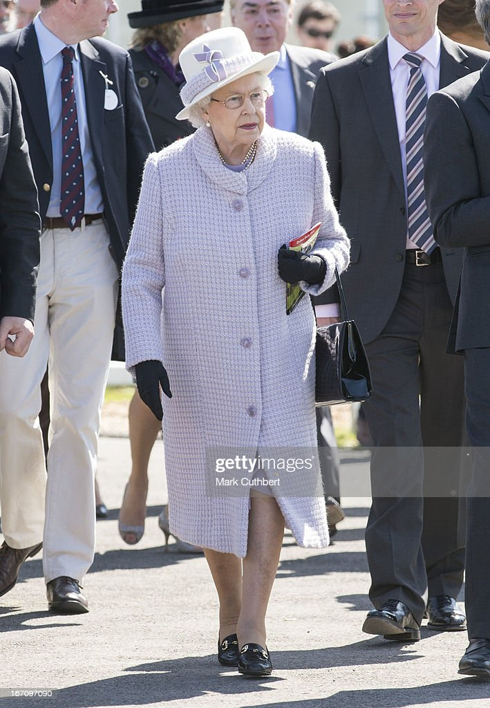 Queen Elizabeth II attends The Dubai Duty Free New to Racing Day where she watched her horse 'Border Legend' in Race 3 'The Berry Bros & Rudd Magnum Spring Cup,' riden by Hayley Turner at Newbury Racecourse on April 20, 2013 in Newbury, England.