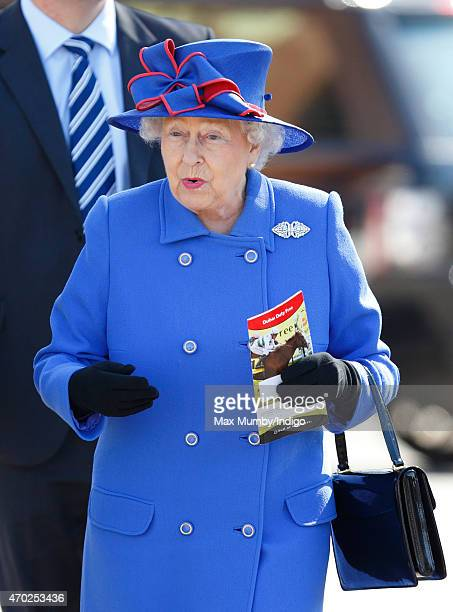 Queen Elizabeth II attends the Dubai Duty Free Spring Trials Meeting at Newbury Racecourse on April 18 2015 in Newbury England
