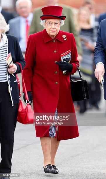 Queen Elizabeth II attends the Dubai Duty Free Spring Trials Meeting at Newbury Racecourse on April 11 2014 in Newbury England