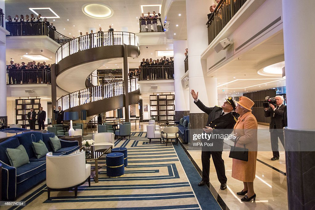 Queen Elizabeth II attends the official naming ceremony of 'Britannia' the new flagship P&O fleet with the ships master, Captain Paul Brown, at Ocean Cruise Terminal on March 10, 2015 in Southampton, England. Britannia will carry over 3647 passengers and at 141,000 tons she will boost P&O's cruise ship capacity by 24%.