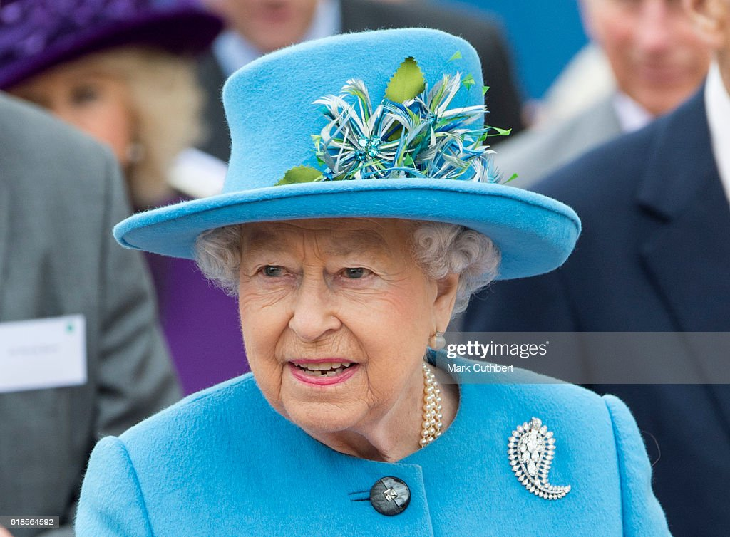 Queen Elizabeth II attends the unveiling of a statue of Queen Elizabeth The Queen Mother during a visit to Poundbury on October 27, 2016 in Poundbury, Dorset.