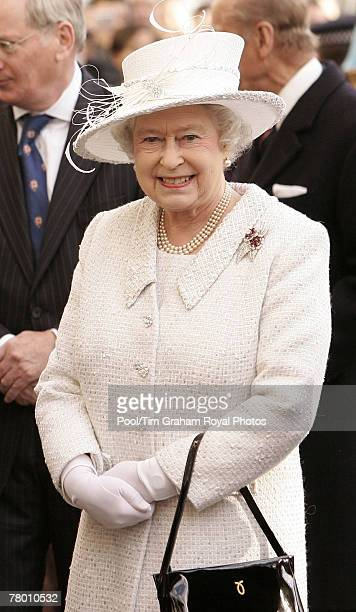 Queen Elizabeth II attends the unveiling of the Jubilee Walkway panel on Parliament Square and meets wellwishers during a walkabout to celebrate her...
