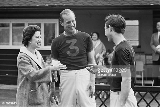 Queen Elizabeth II awarding Prince Philip Duke of Edinburgh and Charles Prince of Wales with trophies after a polo match 30th April 1967