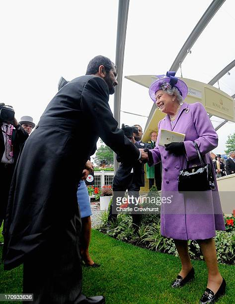 Queen Elizabeth II being congratulated by Sheikh Mohammed bin Rashid Al Maktoum on Ladies' Day during day three of Royal Ascot at Ascot Racecourse on...
