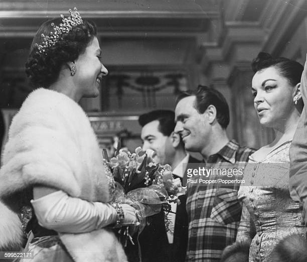 Queen Elizabeth II being introduced to American actress and singer Judy Garland at the Royal Command Variety Performance at the London Palladium...