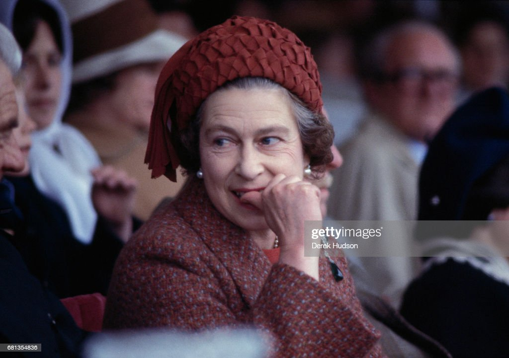 Queen Elizabeth II bites her thumb as she attends the Royal Windsor horse show, Windsor, England, 1975.