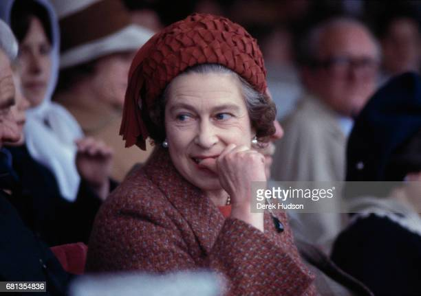 Queen Elizabeth II bites her thumb as she attends the Royal Windsor horse show Windsor England 1975